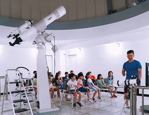 Photos of children by the observatory